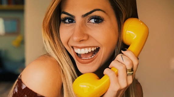 woman with telephone in her hand